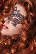Beautiful Girl in a Carnival mask. Masquerade. Beauty portrait r