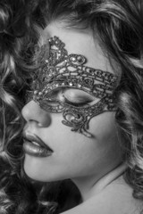 Beautiful Girl in a Carnival mask. Masquerade.Back and white bea