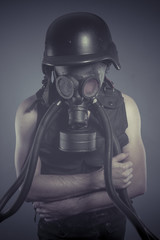 Smoke, Man with black gas mask, pollution concept and ecological