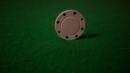 White chip spinning on casino table