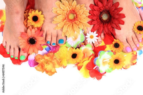 women feets and flowers (pedicure tbackground)