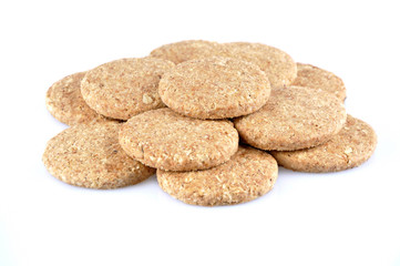 Stack of whole grain cookies isolated on white background