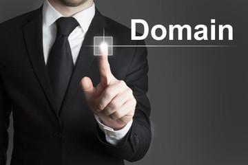 businessman pressing virtual button domain