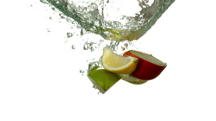 Fruit segments plunging into water on white background