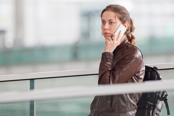 Woman talking on the phone at the airport