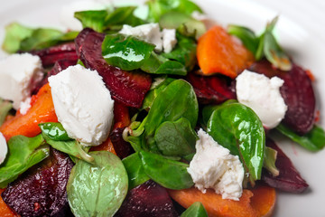 Fresh salad with beet, carrot and mozzarella