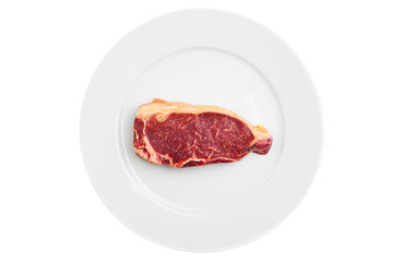 fresh marbled meat on a plate, isolated on white