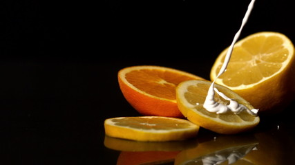 Whipped cream pouring onto orange slices