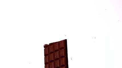 Arrow shooting through a chocolate bar