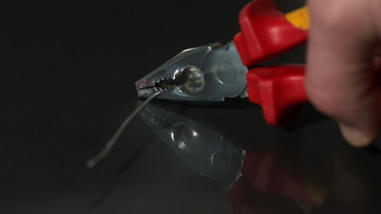 Hand cutting wire with pliers