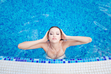 Beautiful woman in hotel swimming pool