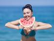 Young woman eats watermelon