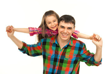 Joyful father with daughter on shoulders