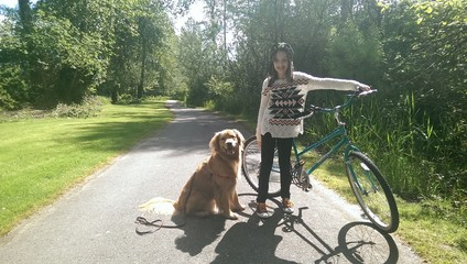 Girl and dog bike rid