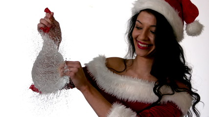 Pretty brunette in santa outfit popping a water balloon