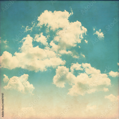 Blue sky with clouds in grunge style. © Elena Volkova
