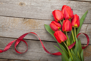 Fresh red tulips with ribbon