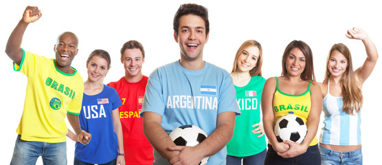 Argentinian soccer fan with ball and other fans