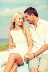 smiling couple at sea side