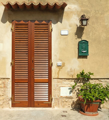 blinded door to the tuscan house