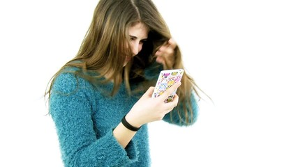 Happy teenager having fun doing selfie with cell phone