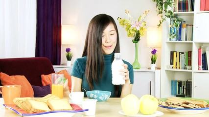 Happy asian woman having heatlhy breakfast at home