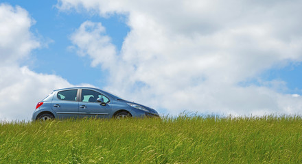 Car parked on a dike in spring