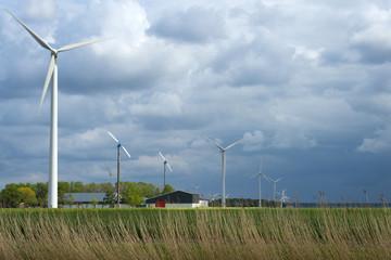 Wind farm under a cloudy sky in spring