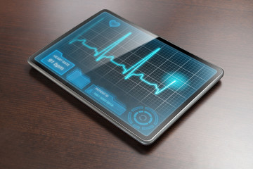 Tablet with medical analysis on table