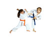 Girl and boy in karategi are training paired exercises karate - 64883962