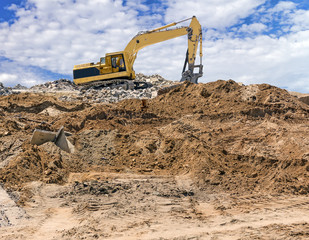 Construction excavator vehicle,demolition site,cloud background