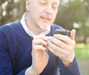 Senior man using his cell phone