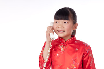 Make a phone call chinese girl in traditional Chinese cheongsam