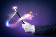 High contrast image of magician hand with magic wand - 64886722