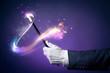 Leinwanddruck Bild - High contrast image of magician hand with magic wand