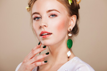 beautiful woman with perfect makeup wearing earrings