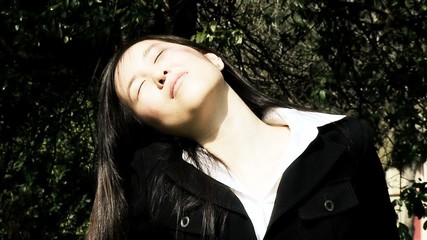 Asian woman enjoying the sun in summer