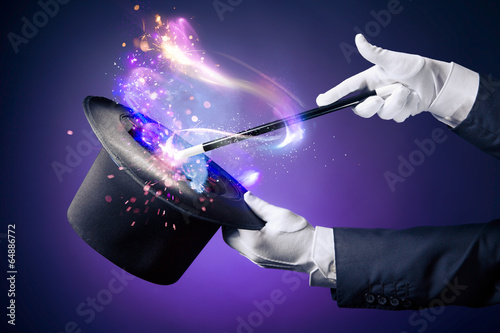 High contrast image of magician hand with magic wand - 64886772
