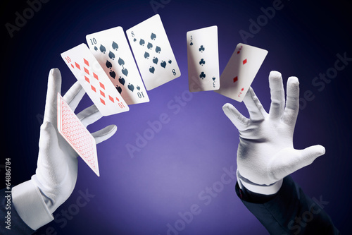 High contrast image of magician making card tricks - 64886784