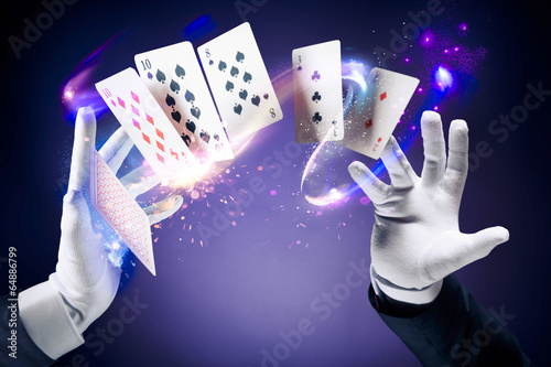 High contrast image of magician making card tricks - 64886799