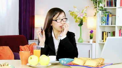 Asian business woman stressed out on the phone