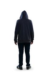 Sad teenage boy standing rear view