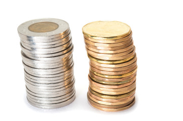 Silver and brass coins stack on white background