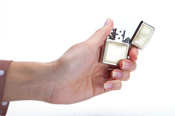 Businesswoman's hand holding lighter