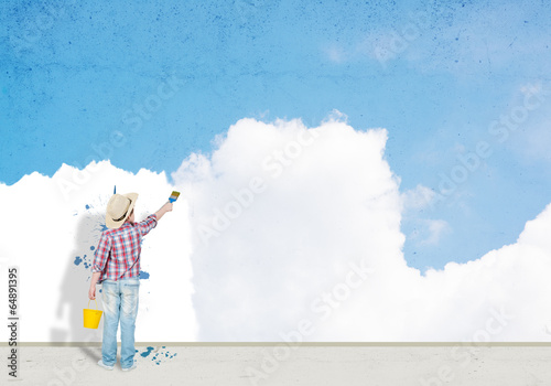 boy paints the wall
