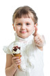 happy child girl eating ice cream and showing thumb up