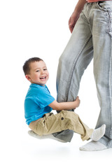 Kid boy playing on  father's foot