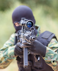 soldier with a gun sighting optics