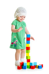 kid playing toy blocks  isolated on white background