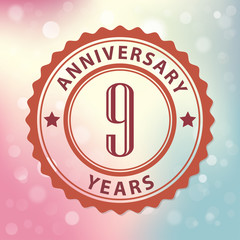 9 Years Anniversary-Retro seal, with colorful bokeh background